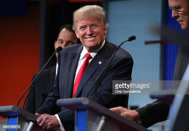 Republican presidential candidate Donald Trump participates in the first primetime presidential debate hosted by FOX News and Facebook at the Quicken...