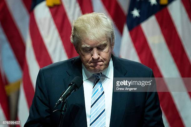 Republican presidential candidate Donald Trump pauses while speaking before introducing his newly selected vice presidential running mate Mike Pence...