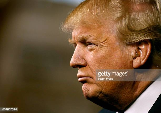 Republican presidential candidate Donald Trump peers out into the crowd during a campaign event at the International Air Response facility on...