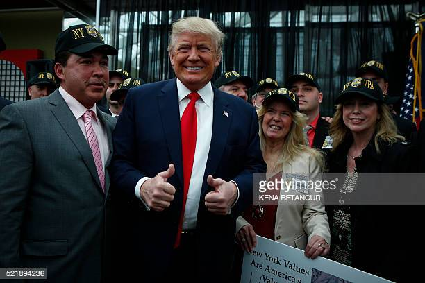 Republican presidential candidate Donald Trump poses for a picture with supporters at the end of a press conference with members of the New York...
