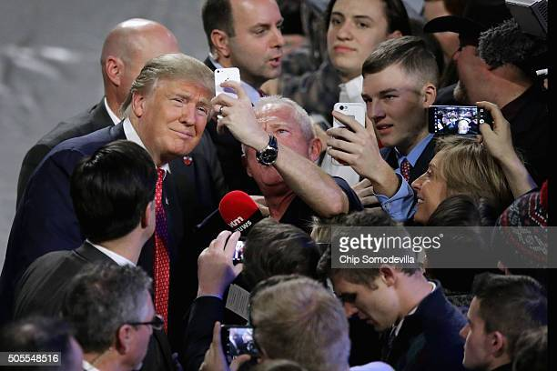 Republican presidential candidate Donald Trump poses for selfies with supporters after delivering the convocation in the Vines Center on the campus...