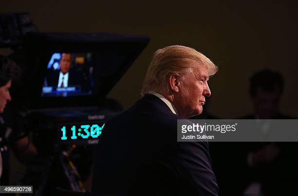 Republican presidential candidate Donald Trump prepares for a television interview in the media in the spin room after the Republican Presidential...