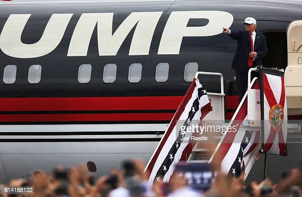Republican presidential candidate Donald Trump prepares to enter his campaign plane after a campaign rally at the Lakeland Linder Regional Airport on...