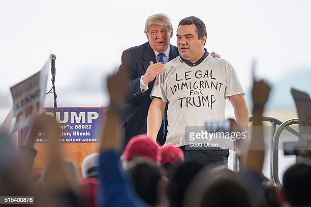 Republican presidential candidate Donald Trump pulls Alex Stypik from a crowd of supporters to show off his shirt during a rally at the Central...