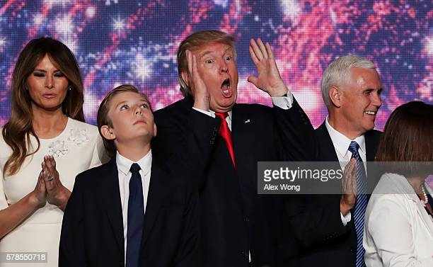 Republican presidential candidate Donald Trump reactes as Republican vice presidential candidate Mike Pence Barron Trump and his wife Melania Trump...