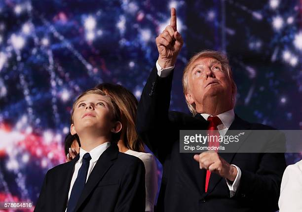 Republican presidential candidate Donald Trump reacts as his son Barron Trump looks on at the end of the Republican National Convention on July 21...