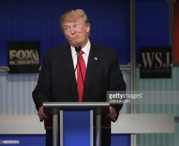 Republican presidential candidate Donald Trump reacts to Carly Fiorina during the Republican Presidential Debate hosted by Fox Business and The Wall...