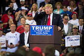 Republican presidential candidate Donald Trump reacts to protestors as he speaks during a campaign event at the CFE Federal Credit Union Arena in...