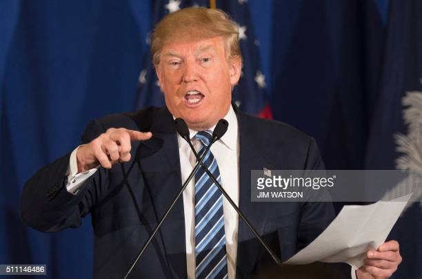 TOPSHOT Republican presidential candidate Donald Trump reads from a statement about Pope Francis during a campaign rally in Kiawah South Carolina...
