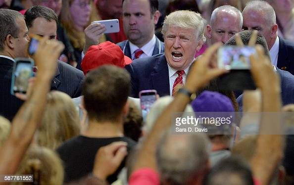 Republican presidential candidate Donald Trump shakes hands with supporters during a campaign event at Trask Coliseum on August 9 2016 in Wilmington...