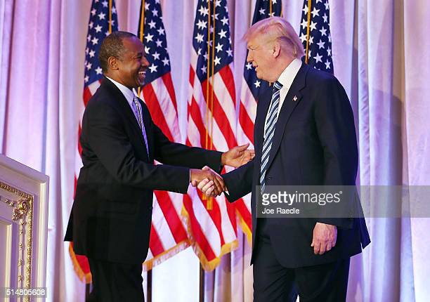 Republican presidential candidate Donald Trump shakes hands with former presidential candidate Ben Carson as he receives his endorsement at the...