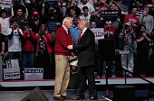 Republican presidential candidate Donald Trump shakes hands with former Indiana University basketball coach Bobby Knight during a campaign rally at...