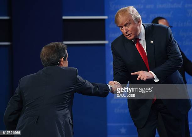 US Republican presidential candidate Donald Trump shakes hands with moderator Chris Wallace after the final presidential debate at the Thomas Mack...