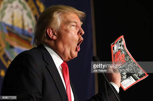 Republican Presidential candidate Donald Trump shows off a Time magazine with a cover story titled 'How Trump Won' during a campaign event at...
