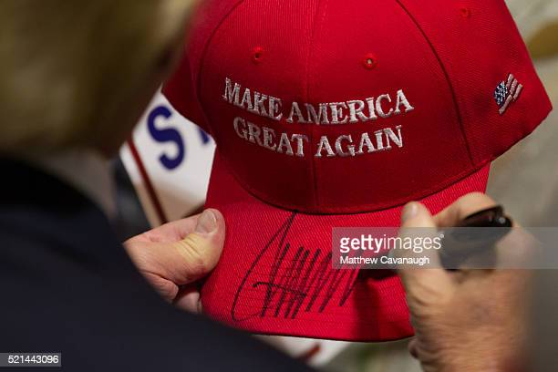 Republican presidential candidate Donald Trump signs a hat after speaking at a rally at the Connecticut Convention Center on April 15 2016 in...