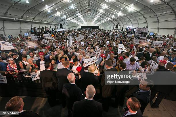 Republican Presidential candidate Donald Trump signs autographs following a campaign rally on June 2 2016 in San Jose California The California...