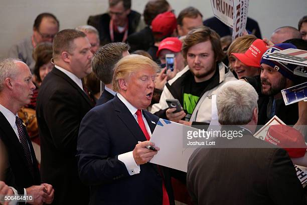 Republican presidential candidate Donald Trump signs autographs after speaking at a campaign event January 23 2016 in Pella Iowa Trump who is seeking...