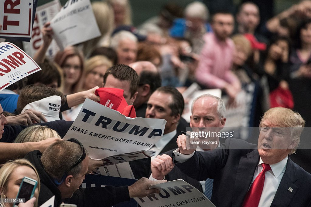 Republican presidential candidate Donald Trump signs autographs at a campaign rally March 7 2016 in Concord North Carolina The North Carolina...