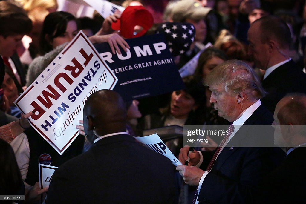 Republican presidential candidate Donald Trump signs autographs for voters during a campaign event February 15 2016 in Greenville South Carolina...