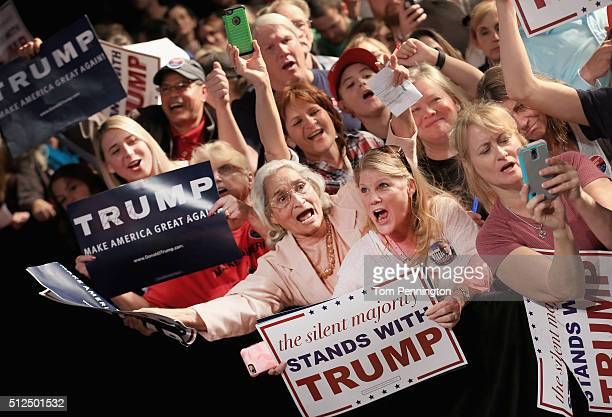 Republican presidential candidate Donald Trump signs autographs for fans at a rally at the Fort Worth Convention Center on February 26 2016 in Fort...