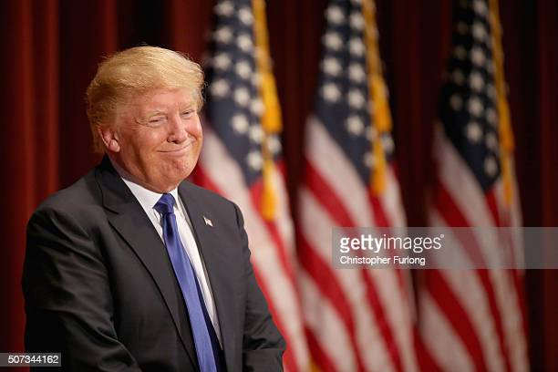 Republican presidential candidate Donald Trump smiles as he speaks to veterans at Drake University on January 28 2016 in Des Moines Iowa Donald Trump...