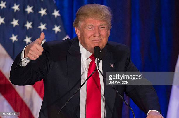 TOPSHOT Republican presidential candidate Donald Trump speaks after finishing second in the Iowa Caucus in West Des Moines Iowa February 1 2016...