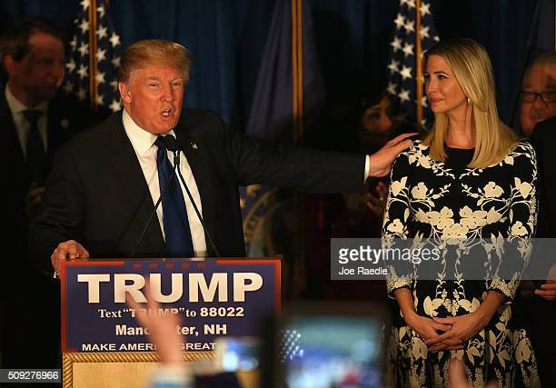 Republican presidential candidate Donald Trump speaks as his daughter Ivanka Trump looks after Primary day at his election night watch party at the...