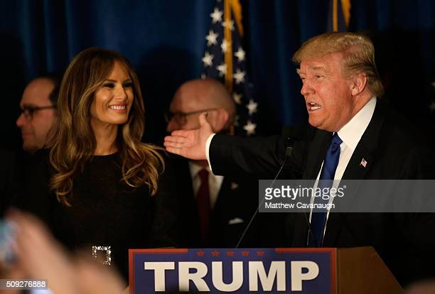 Republican presidential candidate Donald Trump speaks as his wife Melania Trump looks on after Primary day at his election night watch party at the...