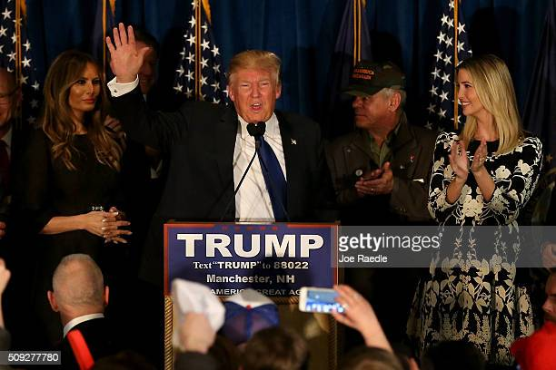 Republican presidential candidate Donald Trump speaks as his wife Melania Trump and daughter Ivanka Trump look on after Primary day at his election...