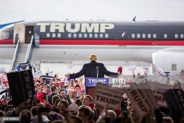 Republican Presidential candidate Donald Trump speaks at a campaign rally in front of his personal airplane March 12 2016 in Vandalia Ohio