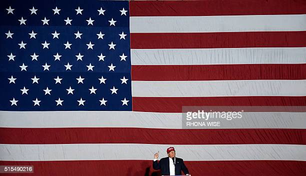 TOPSHOT Republican presidential candidate Donald Trump speaks at a rally on March 13 2016 in Boca Raton Florida Primary voters head to the polls on...