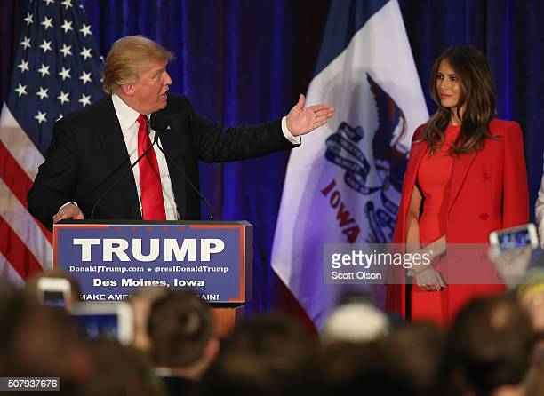 Republican presidential candidate Donald Trump speaks at his Iowa Caucus night gathering while his wife Melania looks on February 1 2016 in Des...
