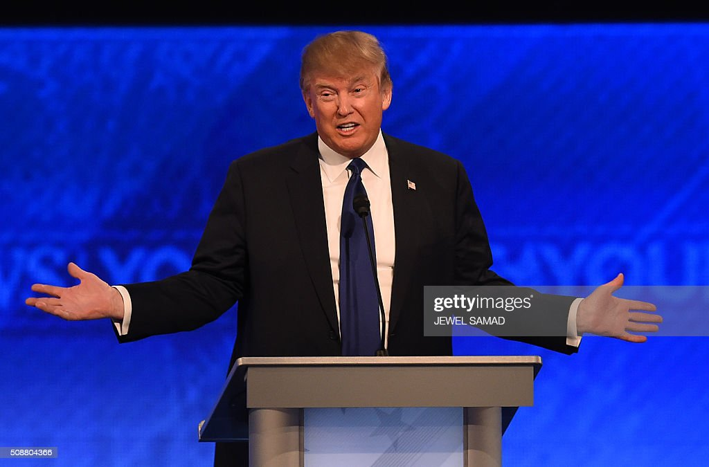 Republican presidential candidate Donald Trump speaks during the Republican Candidates Presidential Debate on February 6, 2016 at St. Anselm's College Institute of Politics in Manchester, New Hampshire. Seven Republicans campaigning to be US president are in a fight for survival in their last debate Saturday before the New Hampshire primary, battling to win over a significant number of undecided voters. / AFP / Jewel Samad