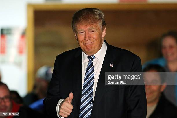 Republican presidential candidate Donald Trump speaks to a small crowd a day before voters go to the polls on February 8 2016 in Salem New Hampshire...