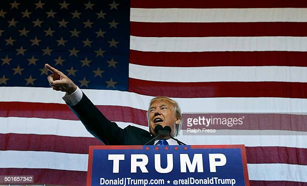 Republican presidential candidate Donald Trump speaks to guest gathered during a campaign event at the International Air Response facility on...