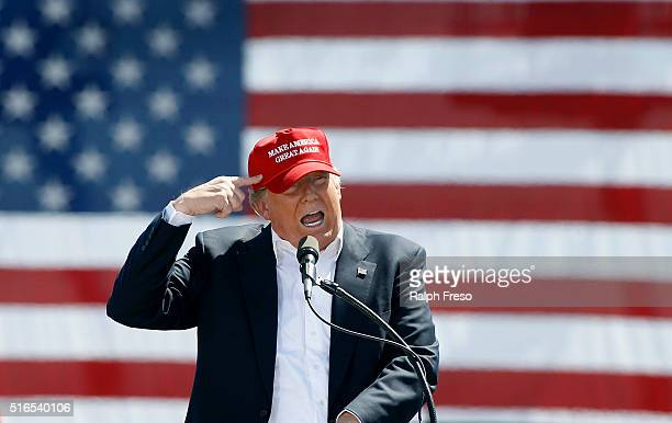 Republican presidential candidate Donald Trump speaks to guest gathered at Fountain Park during a campaign rally on March 19 2016 in Fountain Hills...