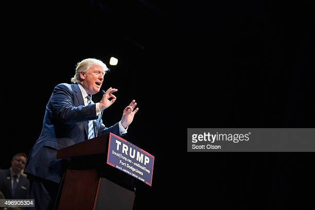 Republican presidential candidate Donald Trump speaks to guests during a campaign stop at Iowa Central Community College on November 12 2015 in Fort...