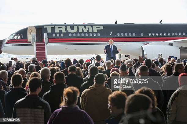 Republican presidential candidate Donald Trump speaks to guests during a rally at the airport on January 30 2016 in Dubuque Iowa Trump is in Iowa...