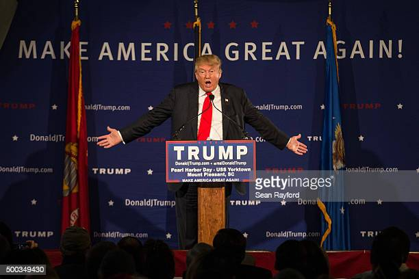 Republican presidential candidate Donald Trump speaks to the crowd at a Pearl Harbor Day Rally at the USS Yorktown December 7 2015 in Mt Pleasant...