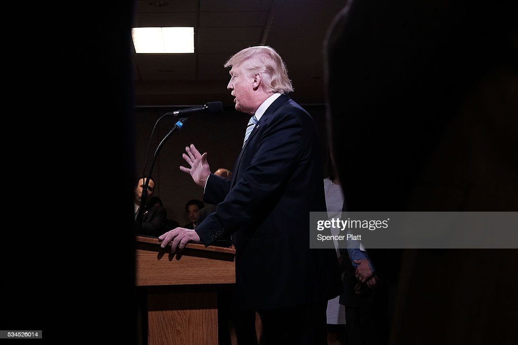 Republican presidential candidate Donald Trump speaks to the media before a rally on May 26, 2016 in Bismarck, North Dakota. According to a delegate count released Thursday, Trump has reached the number of delegates needed to win the GOP presidential nomination.