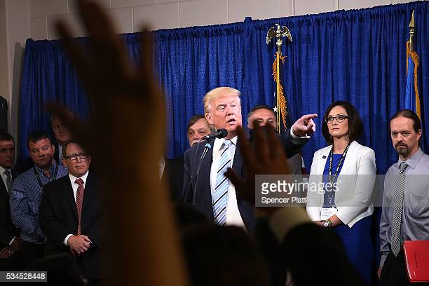 Republican presidential candidate Donald Trump speaks to the media before a rally on May 26 2016 in Bismarck North Dakota According to a delegate...