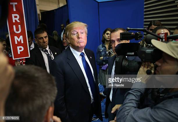 Republican presidential candidate Donald Trump speaks to the media in the spin room after the Republican National Committee Presidential Primary...