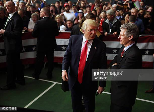 Republican Presidential candidate Donald Trump speaks with former Massachusetts senator Scott Brown after he had endorsed him for president during a...
