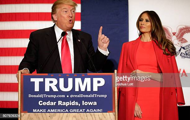 Republican presidential candidate Donald Trump speaks with his wife wife Melania Trump by his side during a campaign event at the US Cellular...