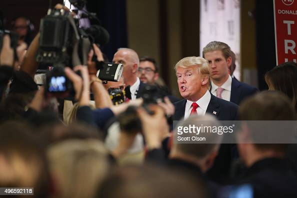 Republican presidential candidate Donald Trump speaks with members of the media in the spin room after the Republican Presidential Debate sponsored...