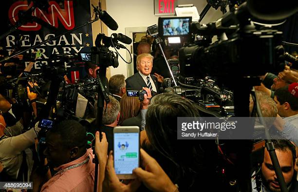 Republican presidential candidate Donald Trump speaks with reporters after the presidential debate at the Reagan Library on September 16 2015 in Simi...