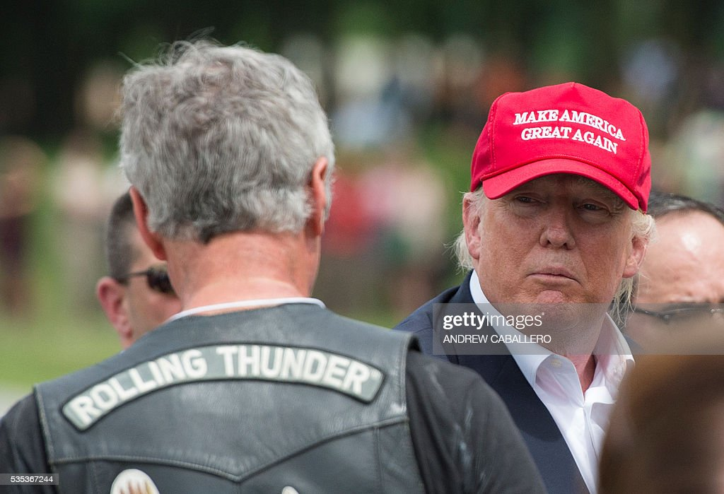 Republican presidential candidate Donald Trump speaks with veterans during an event at the annual Rolling Thunder 'Ride for Freedom' parade ahead of Memorial Day in Washington, DC, on May 29, 2016. / AFP / ANDREW