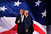 Republican presidential candidate Donald Trump stand with Republican vice presidential candidate Mike Pence and acknowledge the crowd on the third...