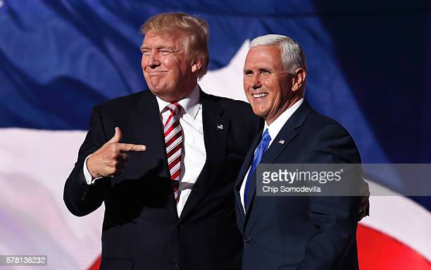 Republican presidential candidate Donald Trump stands with Republican vice presidential candidate Mike Pence and acknowledge the crowd on the third...