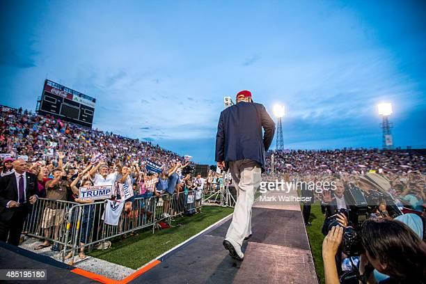 S Republican presidential candidate Donald Trump takes the stage at LaddPeebles Stadium on August 21 2015 in Mobile Alabama The Donald Trump campaign...